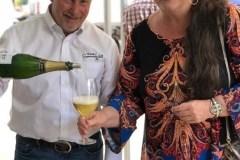 Photo_5_Bill_Norris_and_Carolyn_Ahren_Pouring_Wine
